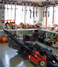 Collection of lawn mowers, trimmers and other yard equipment